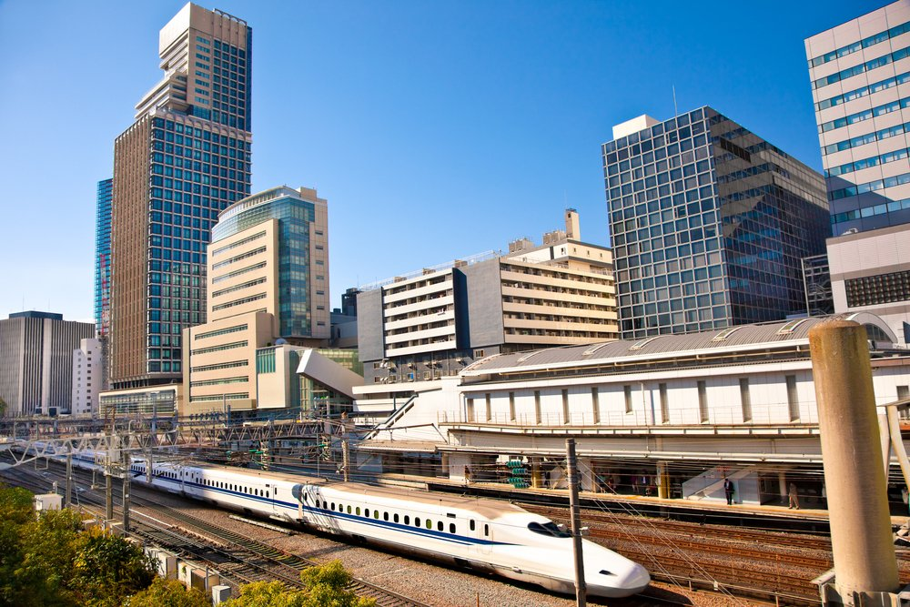 Railway with skyline shinkansen at Odaiba ,Tokyo, Japan. Shinkansen is world's busiest high-speed railway operated by four Japan Railways companies