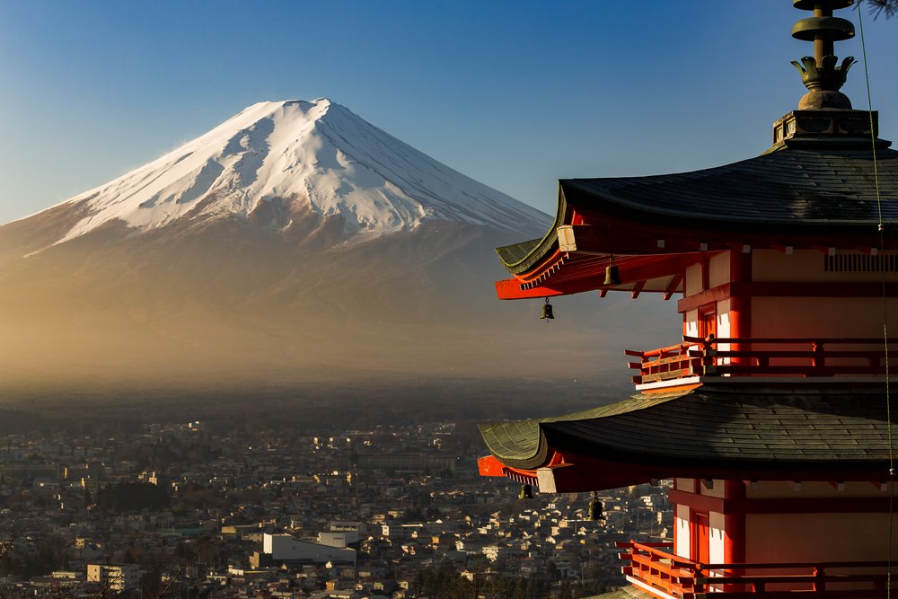 Chureito pagoda in foreground and mount fuji in background during sunrise time. Beautiful nature and human culture